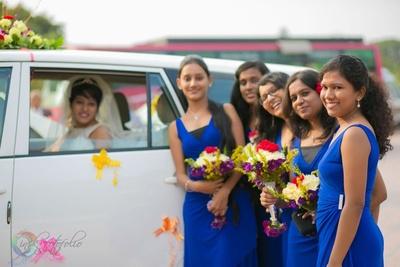 Royal blue bridesmaids dresses with vibrant bouquets