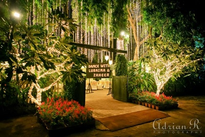 Lush green garden lit up for the sangeet function