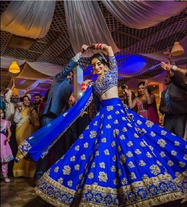 13. Traditional Royal Blue Lehenga With Golden Motifs