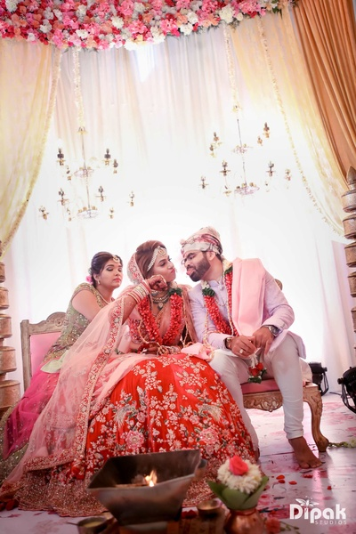 Candid click of the bride and groom at the wedding mandap