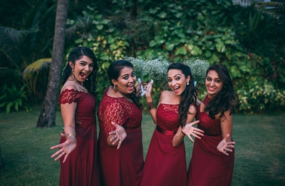 Maroon bridesmaids dressed with a sheer bodice and different necklines