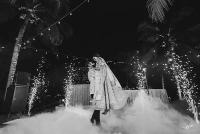 Black and white picture of the couple dancing at the reception