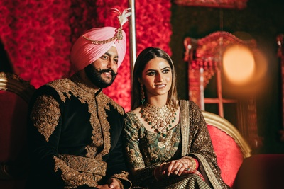 The couple seated on their reception stage, posing for a perfect click!!