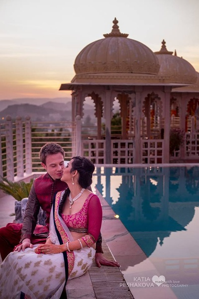 Swati wearing dark pink and white brocade lehenga and Jacob complimenting her in color coordinated outifts for the mehendi ceremony.