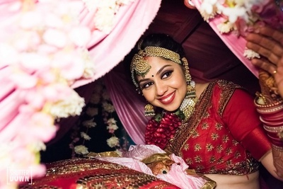 The traditional bride looks out from her palki during her vidaai