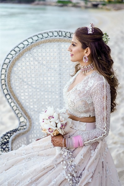 Kaabia looking ethereal in a white lehenga for a beach wedding at Vietnam