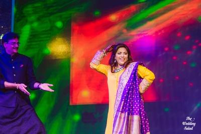 Yellow anarkali dress styled with purple banarsi silk dupatta