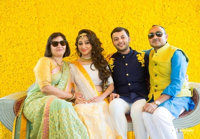Yellow and off-white lehenga, styled with kundan studded gold necklace set and meenakari over-sized maangtikka