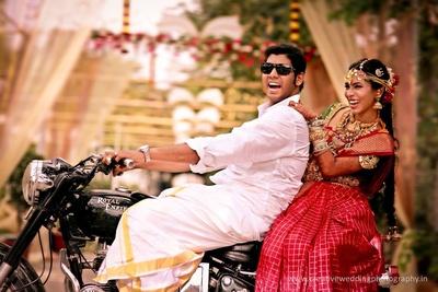 Fun post wedding photo shoot dressed in ethnic wedding attires