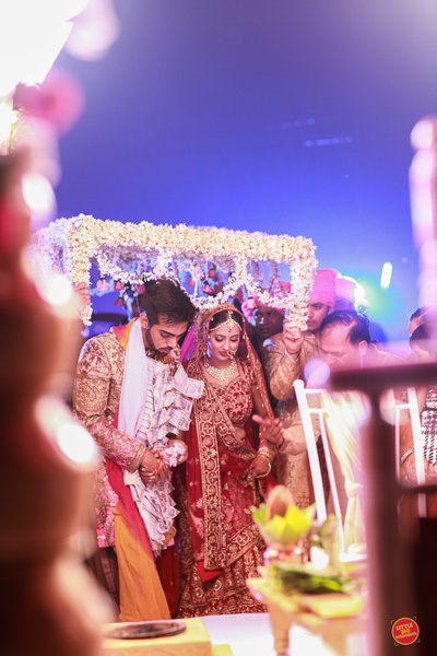 Bride and groom entering the wedding mandap for the wedding ceremony.