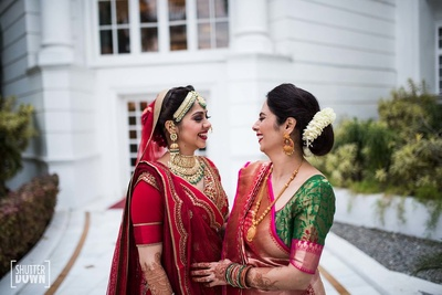 Bride and her mother caught in a candid moment before the wedding