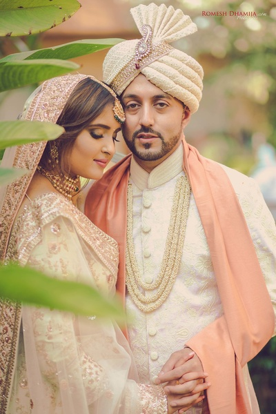 Bride and groom pose together for their post wedding pictures