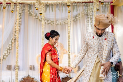 The bride and groom take pheras as part of their wedding ceremony.
