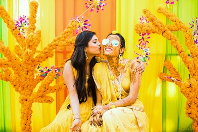The bride having a gala time at her haldi ceremony!