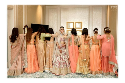 bride and her bridesmaids pose for Ram Bherwani Productions