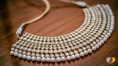 Gold neckpiece studded with kundan work and pearl drops