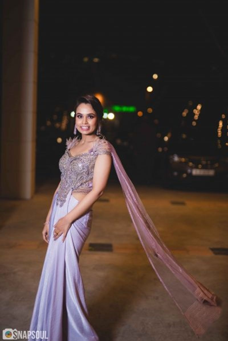 a sister of the bride wearing a concept saree in lilac