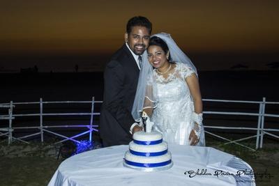Three tier white and blue wedding cake