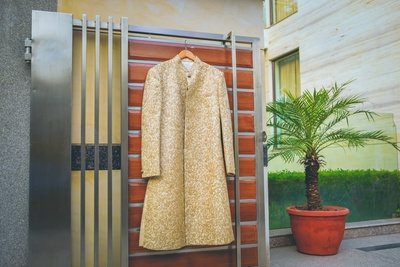 White and Golden Sherwani for the groom for the wedding day.