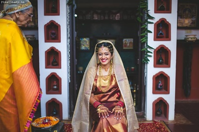 Megha looking pretty in this coorgi styled bridal wear !