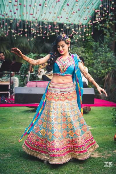 twirling bride in her mehndi lehenga