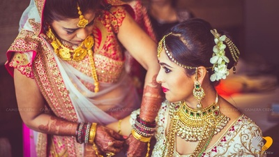 Bride's hairstyle adorned in Juda and Champa flowers