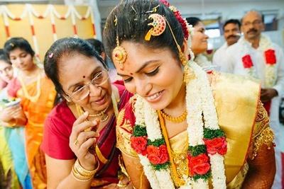 Gold kanjivaram silk saree, styled with gold traditional South Indian jewellery