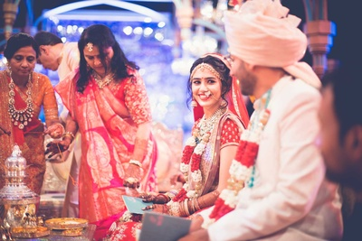 Candid shot between the bride and groom during the wedding ceremony