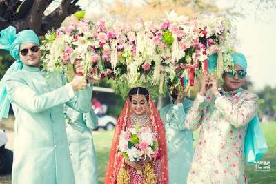 bridal entry under the floral chaadar
