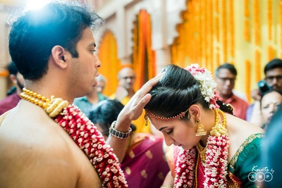 The bride seeking blessings from her better half.