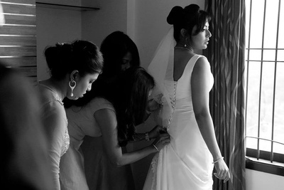 The bridesmaids and maid of honor doing the back button ritual
