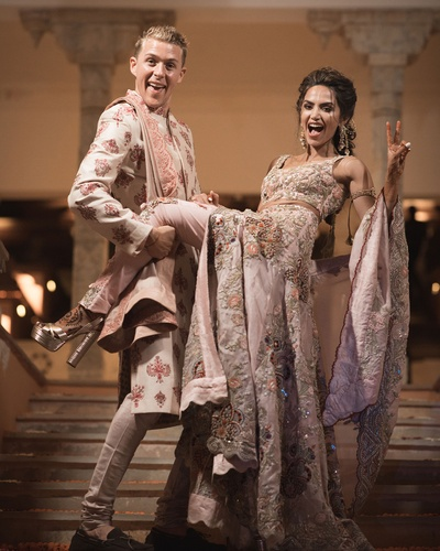 glam sangeet outfit of the bride and groom