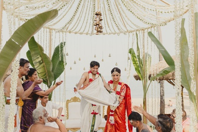 The beautiful couple is all smiles and laughter during their wedding rituals.