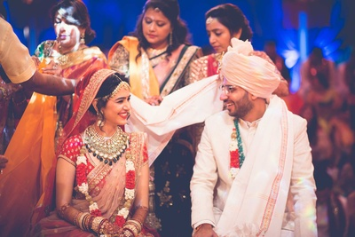 Bride and groom caught in a candid moment during the wedding function