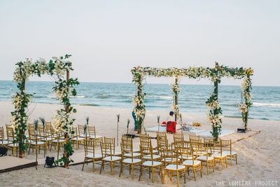 Breathtaaking decor by the beach with a floral mandap!