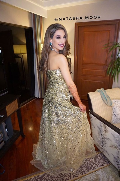 Wearing gold sequined dress by Preeti Singhal for the welcome dinner!