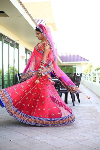 Blush pink wedding lehenga embellished with stones, beads and sequins, styled with a matching dupatta and choli