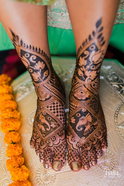 We are flooring over this bride's ethnic mehendi designs with elephant motifs