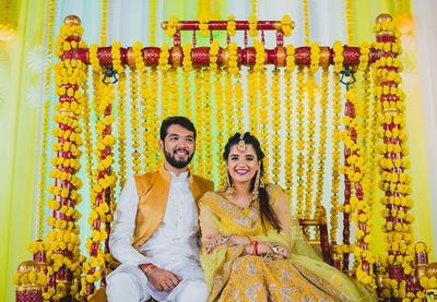 bride and groom at the haldi ceremony