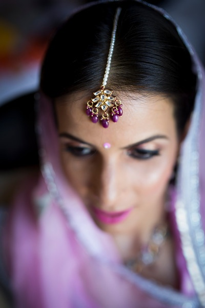 Kundan maangtikka with with a pearl string and stone drop