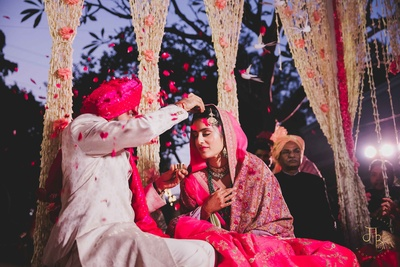 a candid capture of the couple during the sindoor ceremony