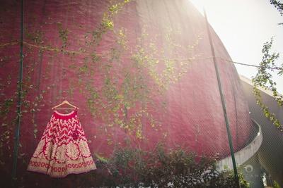 Maroon Sabyaschi lehenga embellished with gold embroidered thread work and beads styled with leheriya border