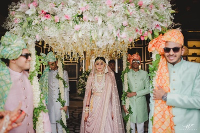 bridal entry under the floral chadar for the wedding ceremony