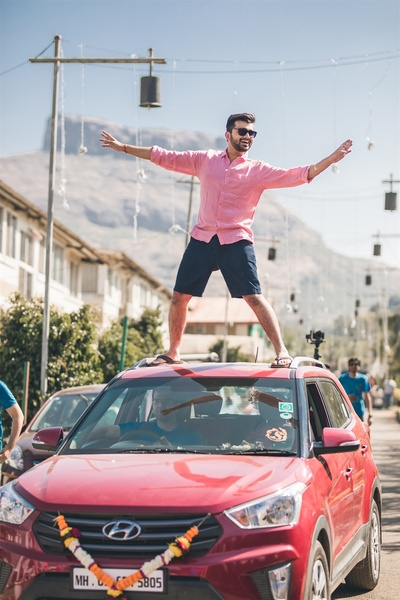 the groom made a statement entry on a car at the mehendi cum holi party