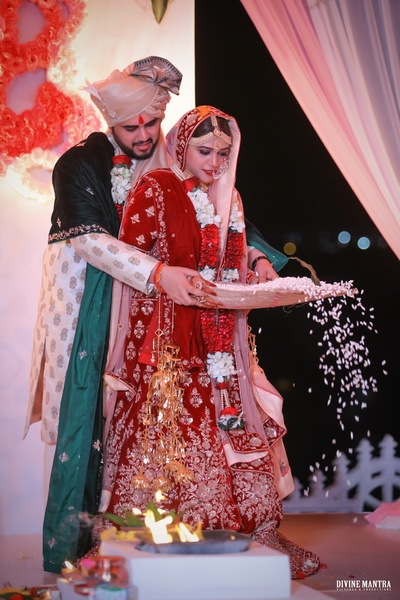 The couple performing a ritual during the wedding ceremony!