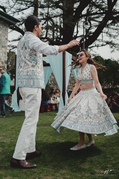 A candid capture of the couple dancing at their pre wedding function