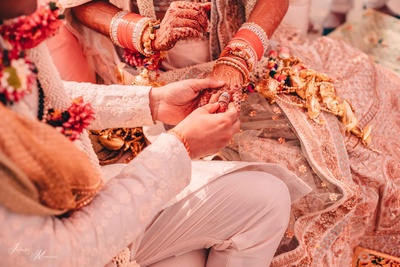 Ring exchange between the bride and groom during the wedding ceremony