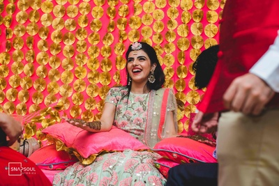 The bride is all smiles at her mehendi ceremony!