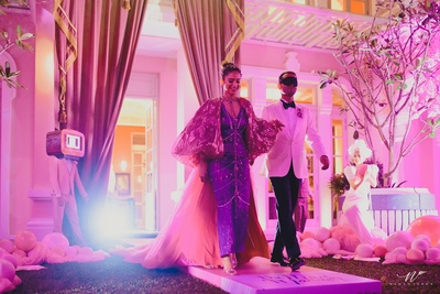 the bride and groom entering their mad house mansion party