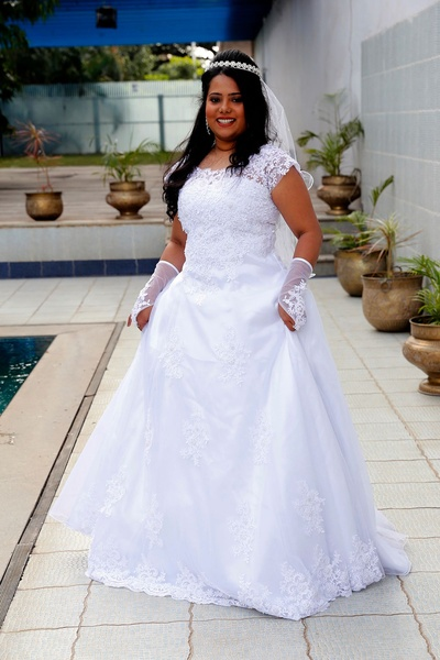 Pearl white flared wedding dress with chantilly lace embellished bodice, styled with matching hand gloves